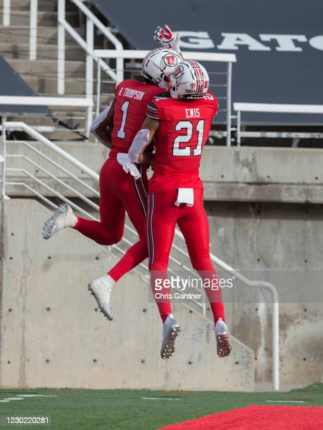 Bryan Thompson of the Utah Utes celebrates scoring a touchdown with teammate Solomon Enis during their game against the Washington State Cougars on...