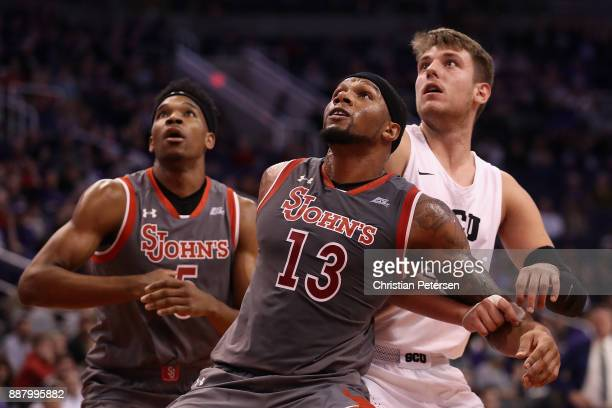 Bryan Trimble Jr #13 of the St John's Red Storm boxes out the Grand Canyon Antelopes during the first half of the college basketball game at Talking...