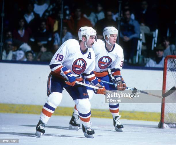 Bryan Trottier and Steve Konroyd of the New York Islanders defend the net during an NHL game in January, 1987 at the Nassau Coliseum in Uniondale,...