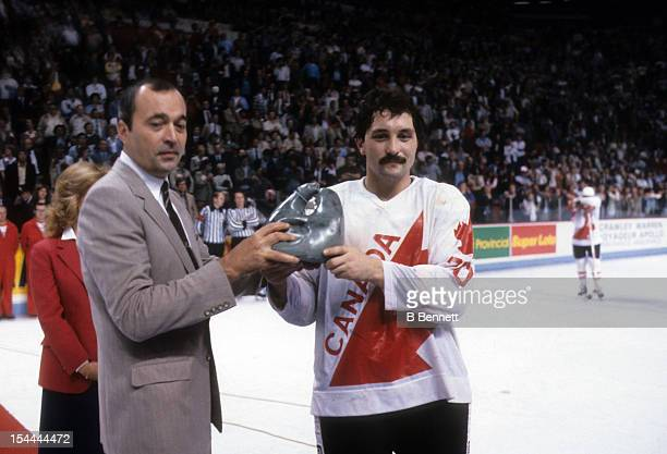 Bryan Trottier of Canada recieves the Labatt Trophy from Sidney M Holland for the player of the game during the 1981 Canada Cup Finals game against...