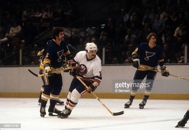 Bryan Trottier of the New York Islanders battles with Larry Giroux of the St Louis Blues during their game on February 22 1979 at the Nassau Coliseum...