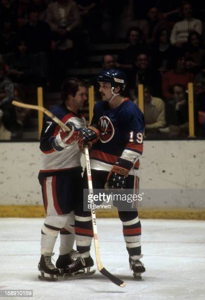Bryan Trottier of the New York Islanders battles with Rod Gilbert of the New York Rangers on November 12 1978 at the Madison Square Garden in New...