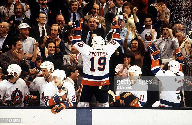 Bryan Trottier of the New York Islanders celebrates with the crowd in the closing minutes of the 1983 Stanley Cup Finals, as the Islanders defeated...