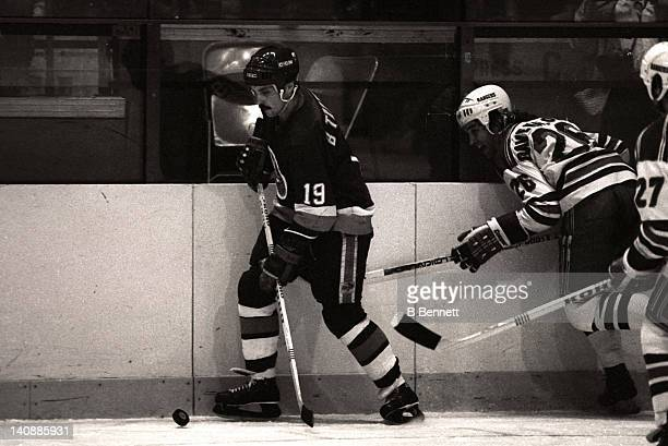Bryan Trottier of the New York Islanders controls the puck as Dave Maloney of the New York Rangers defends during Game 3 of the 1982 Division Finals...