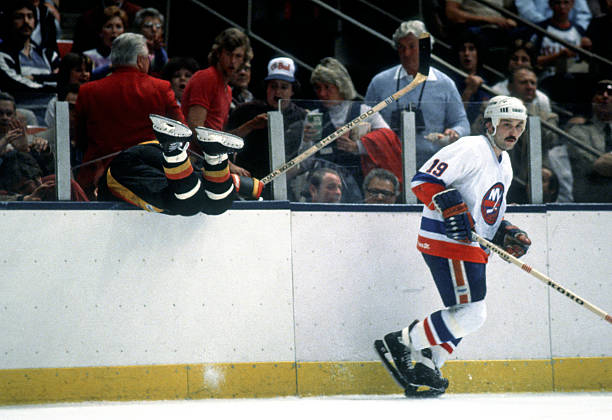 Bryan Trottier Sends A Canuck Through The Glass