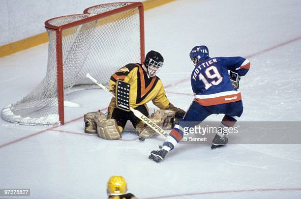 Bryan Trottier of the New York Islanders skates in for a shot on goal against goaltender Richard Brodeur of the Vancouver Canucks during Game Three...