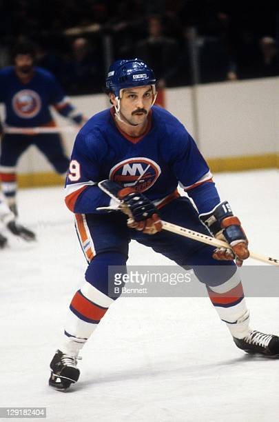 Bryan Trottier of the New York Islanders skates on the ice during an NHL game against the New York Rangers circa 1983 at the Madison Square Garden in...
