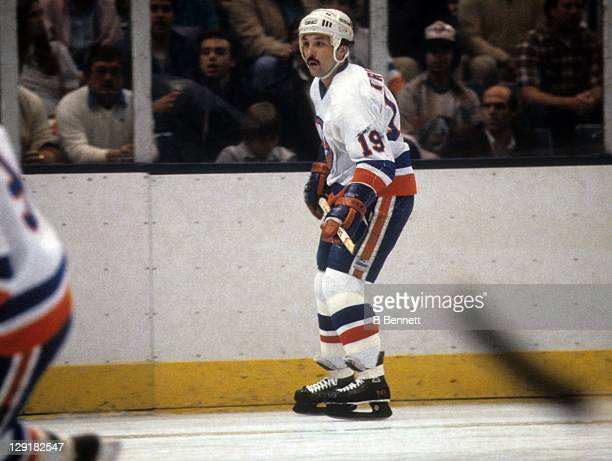 Bryan Trottier of the New York Islanders skates on the ice during an NHL game circa 1984 at the Nassau Coliseum in Uniondale New York