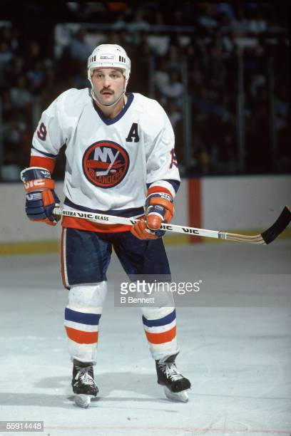 Bryan Trottier of the New York Islanders skates on the ice during an NHL game in January 1986 at the Nassau Coliseum in Uniondale New York
