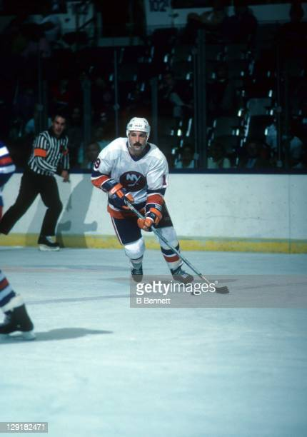 Bryan Trottier of the New York Islanders skates with the puck during an NHL game against the New York Rangers on October 19, 1985 at the Nassau...