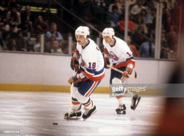 Bryan Trottier of the New York Islanders skates with the puck during an NHL game against the Atlanta Flames on March 3 1979 at the Nassau Coliseum in...