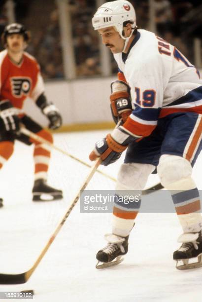 Bryan Trottier of the New York Islanders skates with the puck during an NHL game against the Philadelphia Flyers on April 7 1979 at the Nassau...