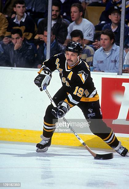 Bryan Trottier of the Pittsburgh Penguins looks to pass the puck during an NHL game against the New York Rangers circa 1993 at the Madison Square...