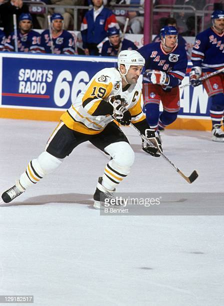 Bryan Trottier of the Pittsburgh Penguins skates on the ice during an NHL game against the New York Rangers on April 16 1992 at the Pittsburgh Civic...