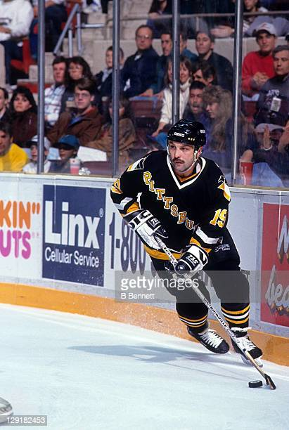 Bryan Trottier of the Pittsburgh Penguins skates with the puck during an NHL game circa 1993