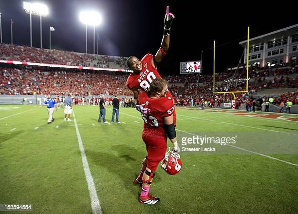 Bryan Underwood of the North Carolina State Wolfpack celebrates after scoring the game winning touchdown with Camden Wentz of the North Carolina...