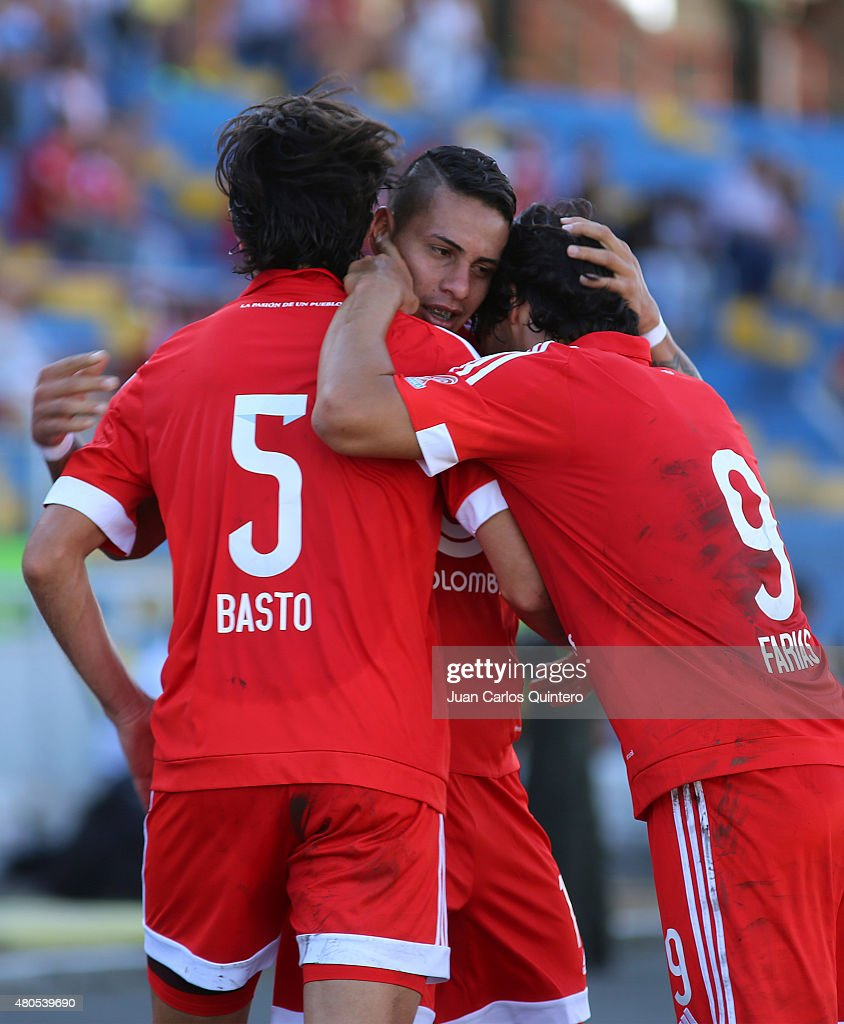 Bryan Urueña of America de Cali celebrates with his teammates after scoring the first goal of his team during a match between America de Cali and Bogota FC as part of 17th round of Torneo Aguila 2015 at 12 de Octubre Stadium on July 12, 2015 in Tulua, Colombia.