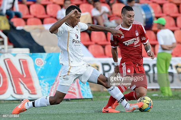 Bryan Urueña of America de Cali struggles for the ball with Cristhian Valencia of Llaneros FC during a match between America de Cali and Llaneros FC...