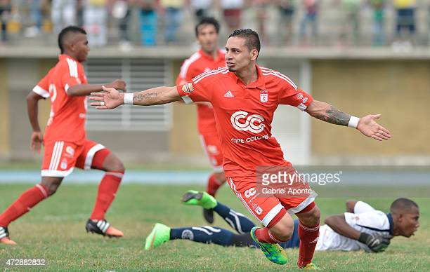 Bryan Uruen–a player of America de Cali celebrates after scoring the first goal of his team during a match between Leones and America de Cali as part...