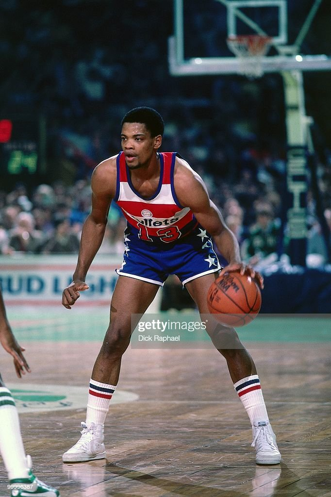 Bryan Warrick #13 of the Washington Bullets looks to make a move against the Boston Celtics during a game played in 1983 at the Boston Garden in Boston, Massachusetts.