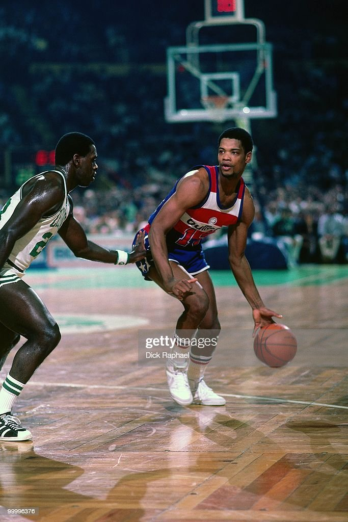 Bryan Warrick #13 of the Washington Bullets moves the ball up court against the Boston Celtics during a game played in 1983 at the Boston Garden in Boston, Massachusetts.