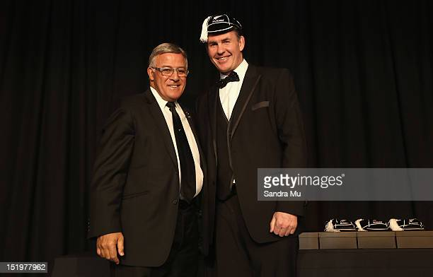 Bryan Williams president of the New Zealand Rugby Union caps former All Black Michael Brewer during the New Zealand All Blacks reunion dinner on...
