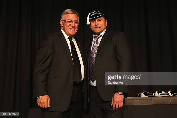 Bryan Williams president of the New Zealand Rugby Union caps former All Black Frano Botica during the New Zealand All Blacks reunion dinner on...
