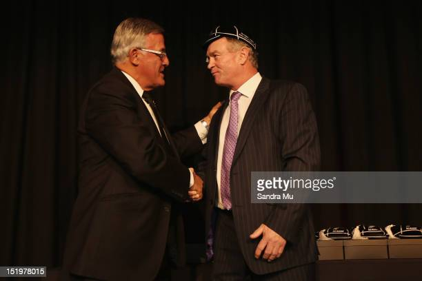 Bryan Williams president of the New Zealand Rugby Union caps former All Black Grant Fox during the New Zealand All Blacks reunion dinner on September...