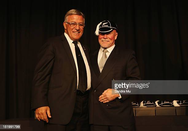 Bryan Williams president of the New Zealand Rugby Union caps former All Black Grant Batty during the New Zealand All Blacks reunion dinner on...