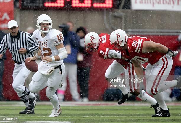 Bryan Wilson and Adam Carriker of the Nebraska Cornhuskers move to sack quarterback Colt McCoy of the Texas Longhorns on October 21, 2006 at Memorial...