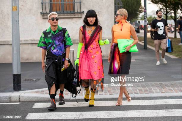 Bryanboy Susanna Lau wearing a neon fuchsia dress and Tina Leung wearing a neon outfit are seen in the streets of Milano before the Prada show during...
