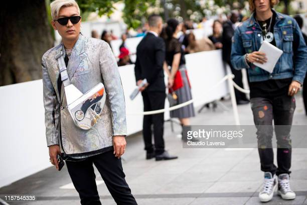 Bryanboy wearing a silver decorated blazer black trousers and silver Dior bag is seen outside Dior fashion show on Day 4 during the Paris Fashion...