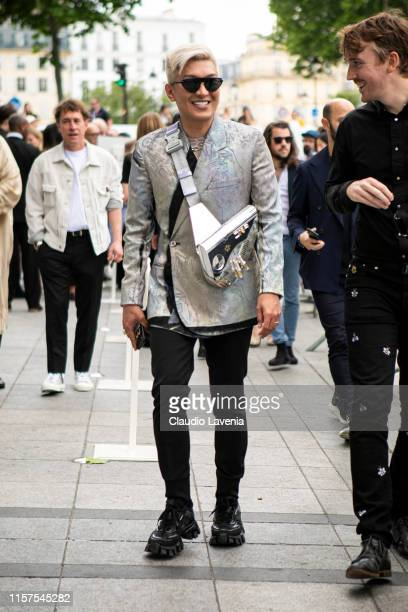 Bryanboy wearing a silver decorated blazer black trousers black Prada sneakers and silver Dior bag is seen outside Dior fashion show on Day 4 during...