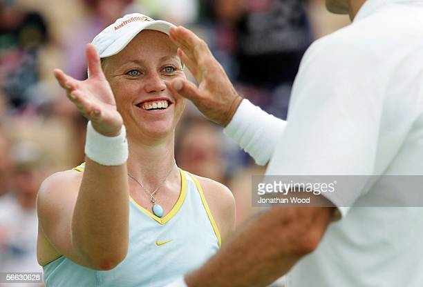Bryanne Stewart of Australia celebrates with Jim Thomas of the USA in their doubles match against Trudi Musgrave and Nathan Healey of Australia...