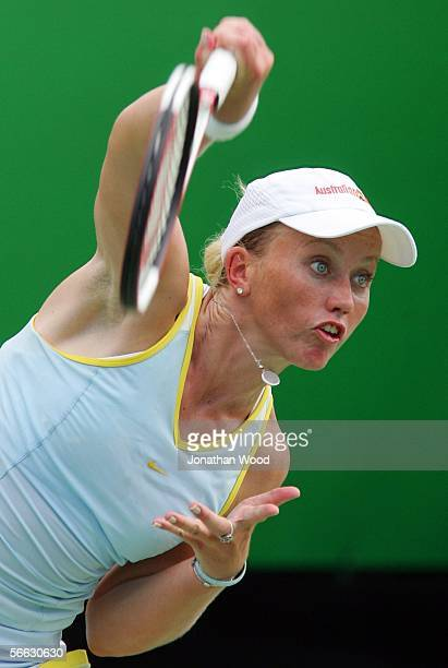 Bryanne Stewart of Australia serves in her doubles match with Jim Thomas of the USA against Trudi Musgrave and Nathan Healey of Australia during day...