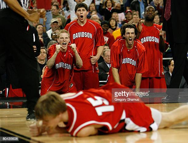 Bryant Barr Stephen Rossiter and William Archambault of the Davidson Wildcats cheer after teammate Thomas Sander made a basket and was fouled in the...