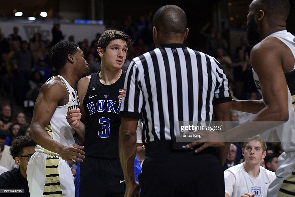 Bryant Crawford #13 of the Wake Forest Demon Deacons and Grayson Allen #3 of the Duke Blue Devils react following a stop in play in front of the Duke bench at LJVM Coliseum Complex on January 28, 2017 in Winston-Salem, North Carolina. Duke won 85-83.