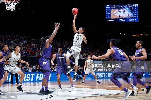 Bryant Crawford of the Wake Forest Demon Deacons shoots the ball against the Kansas State Wildcats in the first half during the First Four game in...