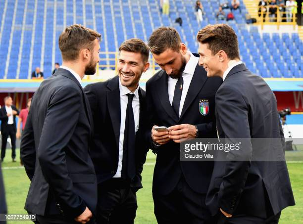 Bryant Cristante Alessio Romagnoli Gianluigi Donnarumma and Mattia Caldara of Italy chat during Italy walk around at Stadio Renato Dall'Ara on...