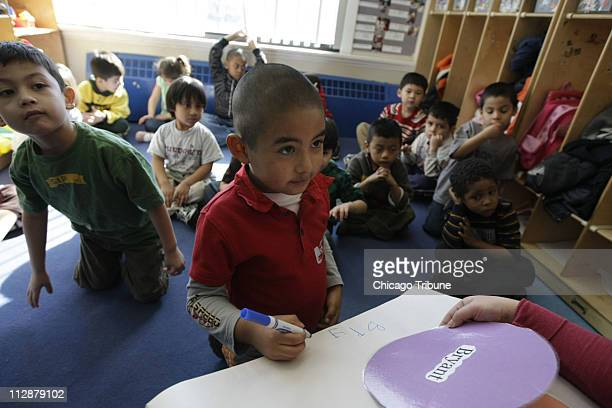 Bryant Cruz pauses as he tries to spell his name during a drill in Janeth Medellin's preK class at Casa Infantil in the Logan Square neighborhood...