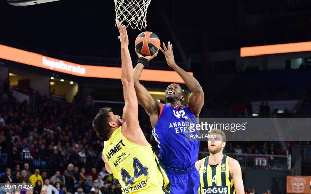 Bryant Dunston #42 of Anadolu Efes Istanbul competes with Ahmet Duverioglu #44 of Fenerbahce Dogus Istanbul during the 2017/2018 Turkish Airlines...