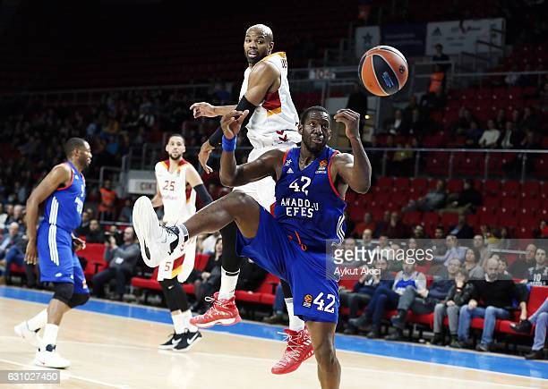 Bryant Dunston #42 of Anadolu Efes Istanbul competes with Alex Tyus #7 of Galatasaray Odeabank Istanbul during the 2016/2017 Turkish Airlines...