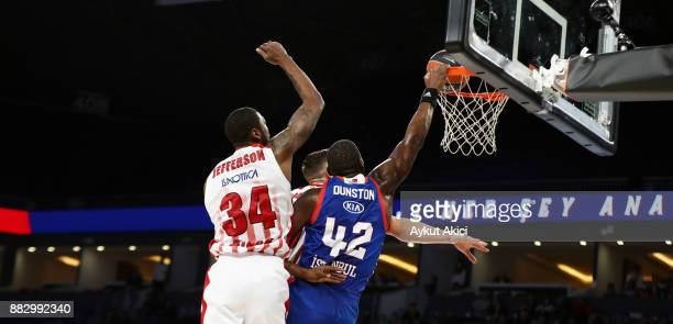 Bryant Dunston #42 of Anadolu Efes Istanbul competes with Cory Jefferson #34 of AX Armani Exchange Olimpia Milan during the 2017/2018 Turkish...