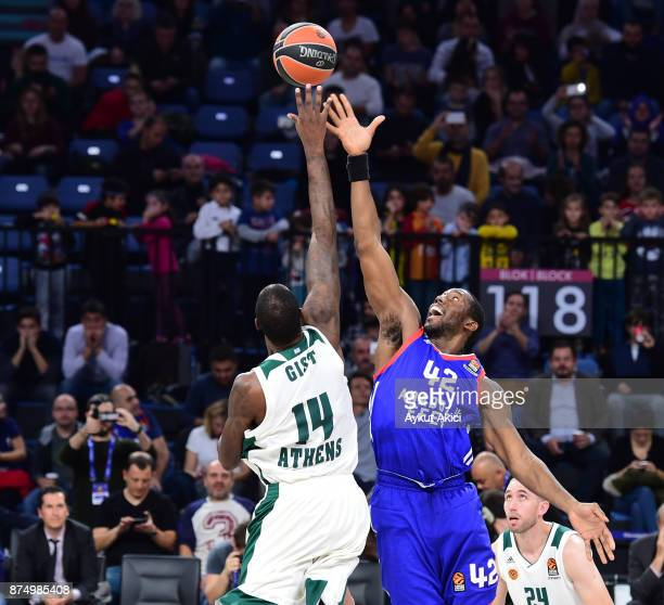 Bryant Dunston #42 of Anadolu Efes Istanbul competes with James Gist #14 of Panathinaikos Superfoods Athens during the 2017/2018 Turkish Airlines...