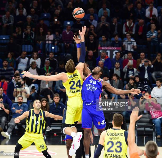 Bryant Dunston #42 of Anadolu Efes Istanbul competes with Jan Vesely #24 of Fenerbahce Istanbul during the 2018/2019 Turkish Airlines EuroLeague...