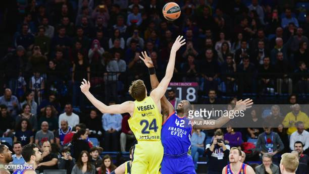 Bryant Dunston #42 of Anadolu Efes Istanbul competes with Jan Vesely #24 of Fenerbahce Dogus Istanbul during the 2017/2018 Turkish Airlines...