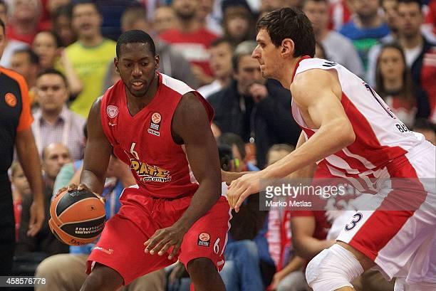 Bryant Dunston, #6 of Olympiacos Piraeus competes with Boban Marjanovic, #13 of Crvena Zvezda Telekom Belgrade during the 2014-2015 Turkish Airlines...