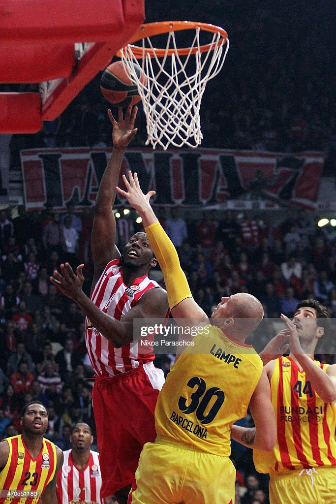 Bryant Dunston #6 Of Olympiacos Piraeus Competes With Maciej Lampe #30 Of  FC Barcelona