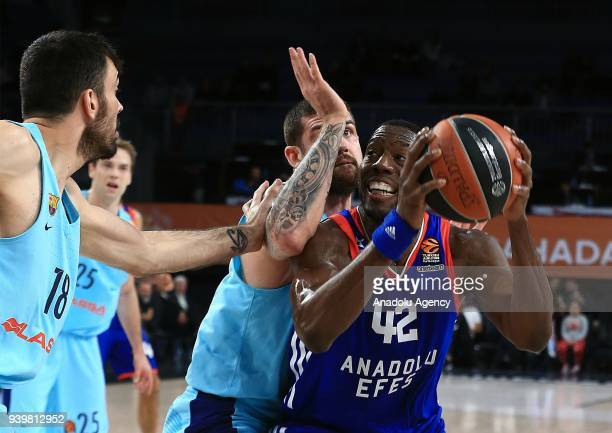 Bryant Dunston of Anadolu Efes in action against Pierre Oriola and Adrien Moerman of Barcelona Lassa during the Turkish Airlines Euroleague week 29...