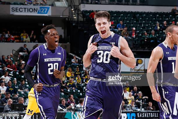 Bryant McIntosh and Scottie Lindsey of the Northwestern Wildcats celebrate against the Michigan Wolverines in the second round of the Big Ten...